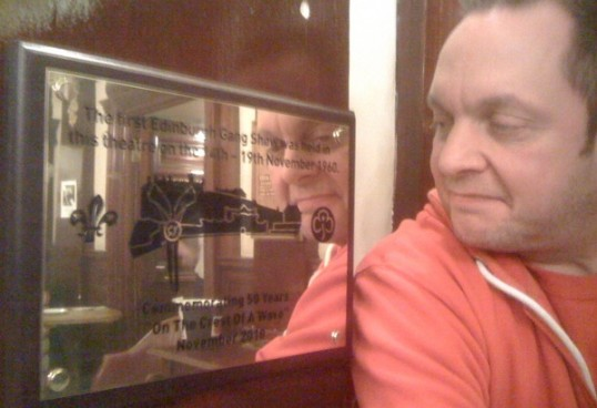 Gang Show director Andy Johnston examines the plaque commemorating 50 years of Gang Shows at the Edinburgh King's
