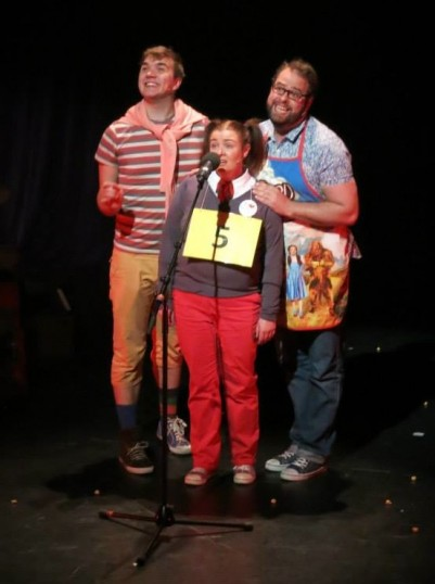 Logainne SchwartzandGrubenierre (Judith Barron) with her two dads. Photo © Carole Gibson