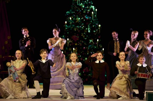 Amy Pollock as Clara, Jamie Campbell as Fritz with Party Children in Peter Darrell's The Nutcracker. Photo by Andy Ross