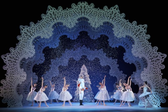 Amy Pollock as Clara, with Remi Andreoni as the Nutcracker Prince, Luciana Ravizzi as the Snow Queen and Company members in Peter Darrell's The Nutcracker. Photo by Andy Ross