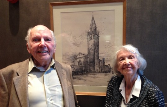 Deryk Gould and Christelle Steele with a copy of architect Hippolyte Blanc's drawing for the original church. The tower was never built. Photo Thom Dibdin