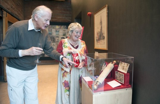EPT's Gordon Braidwood and Irene Beaver examine CHT's exhibition, showcasing memorabilia from performances past. Photo: Jane Barlow