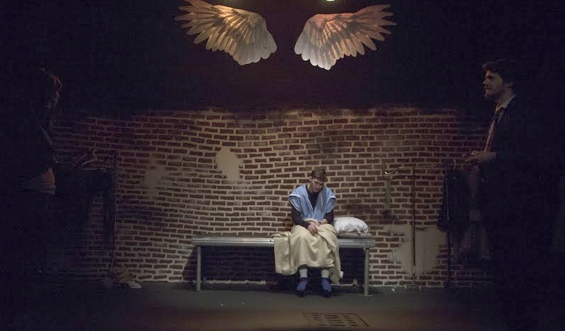 A scene from Angels In America with (left to right) Meera Muñoz Pandya as Belize, Brooks Hudgins as Prior Walter, and Rob Younger as Louis Ironson